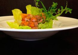 Pork in aspic served on a seasonal salad with a pumpkin seed dressing