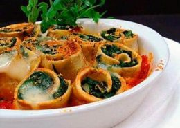 Spinach cannelloni topped with baked cheese